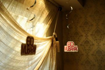 Eid greetings hang as decorations in home of Yemeni-American Muslim Udayni family on Eid al-Fitr holiday in New York