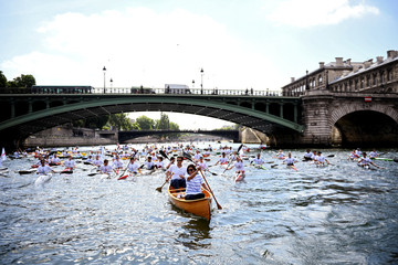 Paris Mayor Anne Hidalgo and the co-president of the Paris bid for the 2024 Olympics Tony Estanguet paddle on the Seine River in Paris