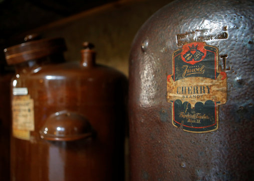 Historic liquor containers stand on a shelf at the Old Viennese Schnapsmuseum, a historic distillery in Vienna