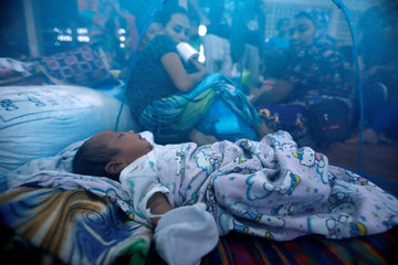 An evacuated newborn sleeps inside a mosquito net at an evacuation center outside Marawi, as government forces continue their assault against insurgents from the Maute group in Marawi