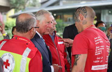 Britain's Prince Charles meets Red Cross volunteer Carl Chant during a visits the Westway Sports Centre, which is acting as a relief centre for those affected by the Grenfell Tower fire, in London