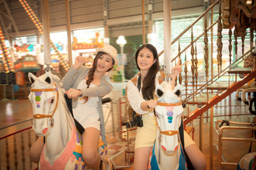 asian pretty girls going to the amusement park