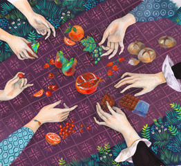 Hand picking up fruit and chocolate from a picnic blanket