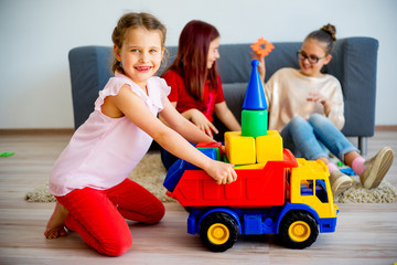 Girls with toy car