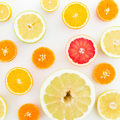 Citrus fruits on white background. Flat lay, top view. Fruit's background or pattern