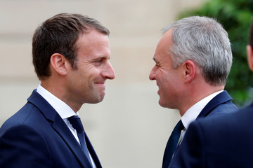 French President Emmanuel Macron greets newly elected speaker of the French National Assembly Francois de Rugy upon his arrival at the Elysee Palace in Paris