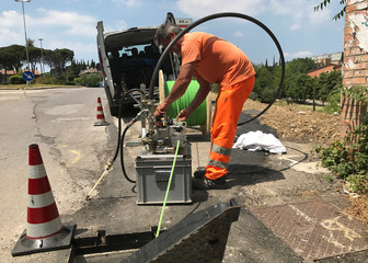 A worker is seen installing fiber optic cables in Perugia