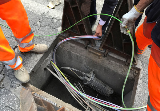 Workers are seen installing fiber optic cables in Perugia