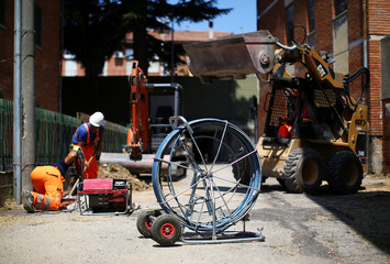 A reel of optical fiber cable is seen as technicians install it on behalf of Enel Group in a road in Perugia