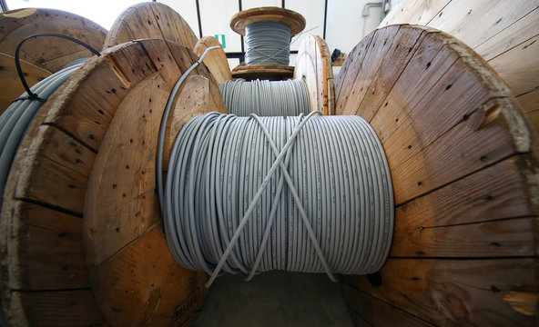 Reels of optical fiber cables are seen in a storage area in Perugia