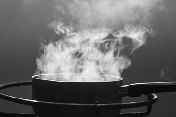 Steam over cooking pot.Selective focus