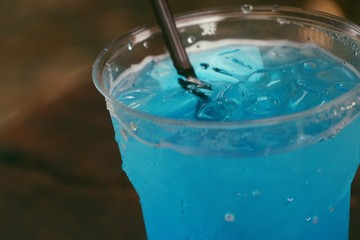 Blue soda drinking water