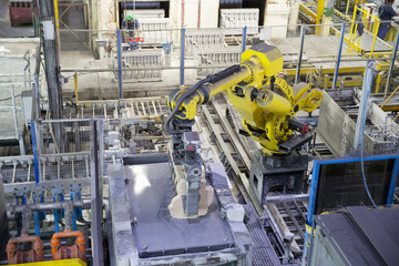 Elevated View Of Robotic Engine Manufacturing Production Line