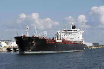 Chemical tanker ship alongside a berth in port