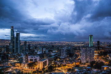 Amazing wallpaper Bogotà city on Night, Colombia, America. Cloudy sky