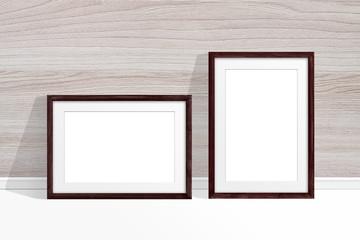 Two blank photo frames near wooden wall, decor mockup