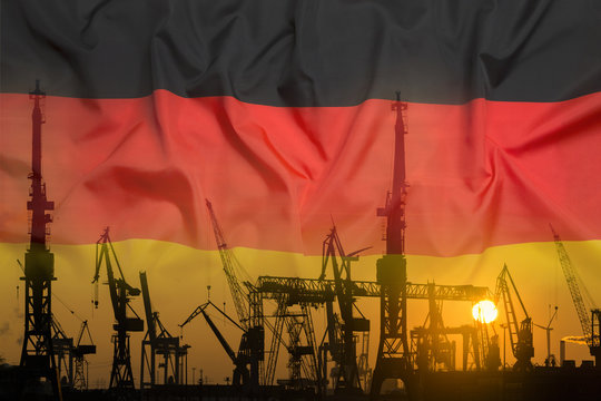 Industrial concept with Germany flag at sunset