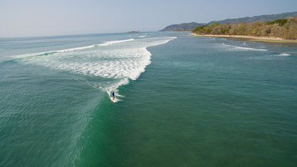 Aerial view of a surfer on a wave in Santa Teresa, Costa Rica