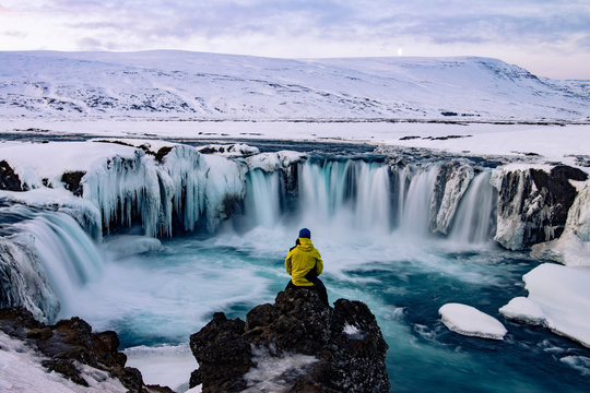 Adventurous man at Godafoss, Iceland in winter