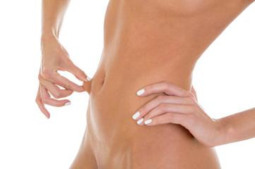 Beautiful slim woman body isolated on white background.