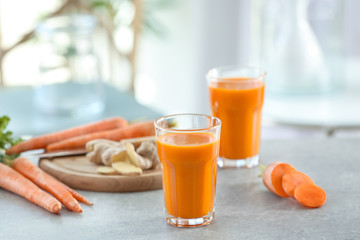 Glasses of carrot juice on light table