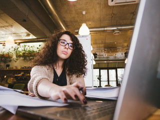 Young woman working in the office and using computer