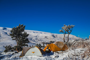 winter camping at the mountain slope