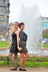 Pretty girls by the fountain on the background of the book - singer on Nevsky prospect