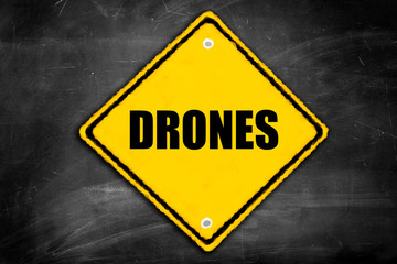 drones written on caution sign