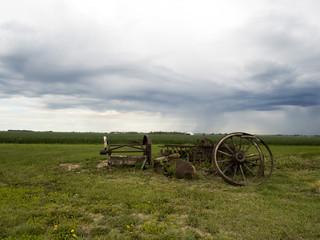 Old Farm equipment scrap metal in the fields: