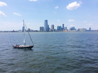 Sailboat on city background