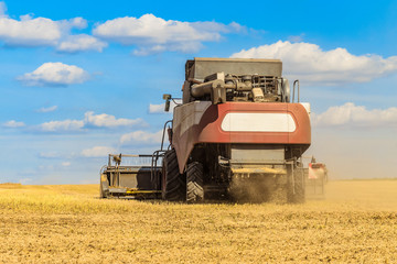 Combine harvester in the field for harvesting. Agricultural machinery, rear view.