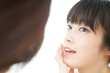 Young woman doing skin care