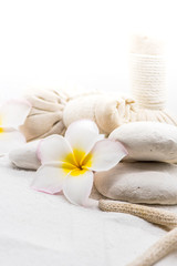 Spa and massage decoration on white sand
