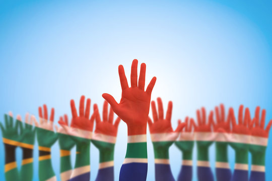 South Africa national flag on leader's palms isolated on blue sky for human rights, leadership, reconciliation concept
