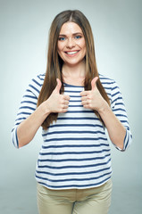 Smiling woman shows thumb up.