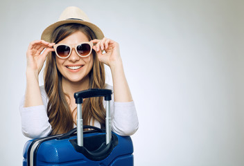 Smiling woman wearing sun glasses and hat