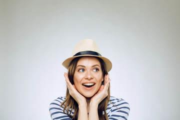 Close up face portrait of happy woman wearing hat