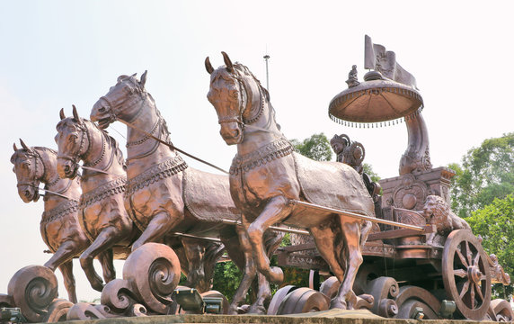 Giant Krishna-Arjuna chariot made of bronze metal, situated at Brahma Sarovar Kurukshetra, Haryana, is a big charm for the pilgrims.