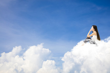 young woman  sitting on cloud and thinking concept