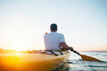 Man paddling the kayak