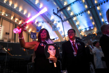A woman waves a light stick during the 96th Miss America Pageant at Boardwalk Hall in Atlantic City