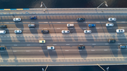 Aerial top view of bridge road automobile traffic of many cars, transportation concept
