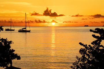 Sunset in sea and sailing yacht silhouette with beautiful landscape of Caribbean, Santa Lucia island