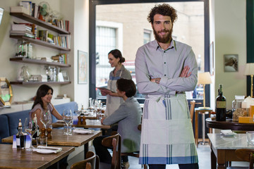 Small business owner smiling in his restaurant