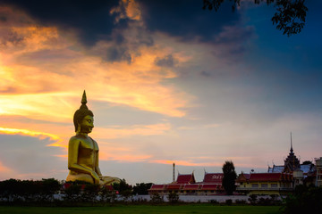 The beauty of the culture at in Asia. At sunset beautiful Buddha statue big in the world.