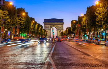 Champs-Elysees and Arc de Triomphe at night in Paris, France