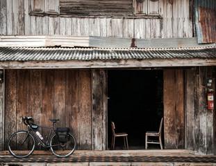 Bike against wooden house in Thailand