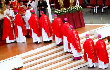 Pope Francis gives the the sacred pallium to new metropolitan archbishops during the Holy Mass for the Solemnity of St. Peter and Paul in Saint Peter's square at the Vatican