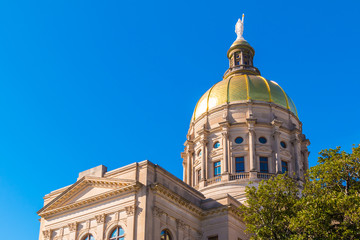 Bottom view of the tholobate and the dome of Georgia State Capitol on the background of clear sky, Atlanta, USA